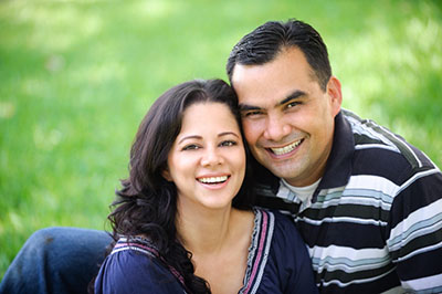Smiling couple on the grass after appointment at Calapooia Family Dental in Albany, OR
